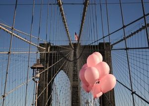 Pink balloons on the brooklyn bridge
