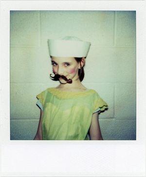 Polaroid mustache girl