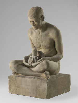 Hack-Marinus-Johannes-Man-and-machine-(nude-Javanese-man-holding-miniature-diesel-engine)-c1913-sandstone-Rijksmuseum