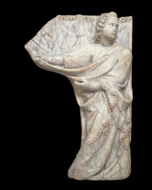 0-Tino-di-Camaino-Angel-drawing-a-curtain-c1320-marble-relief-(from-tomb)-Victoria-&-Albert-Museum